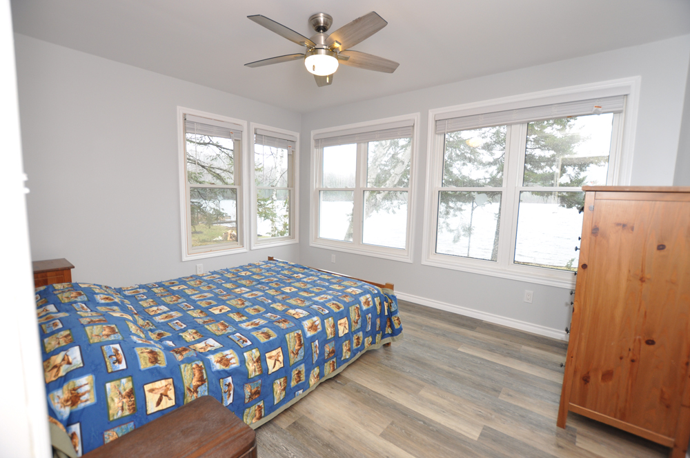 13 Baptiste Lake - Golden Shores - Master Bedroom - Queen view to the lake
