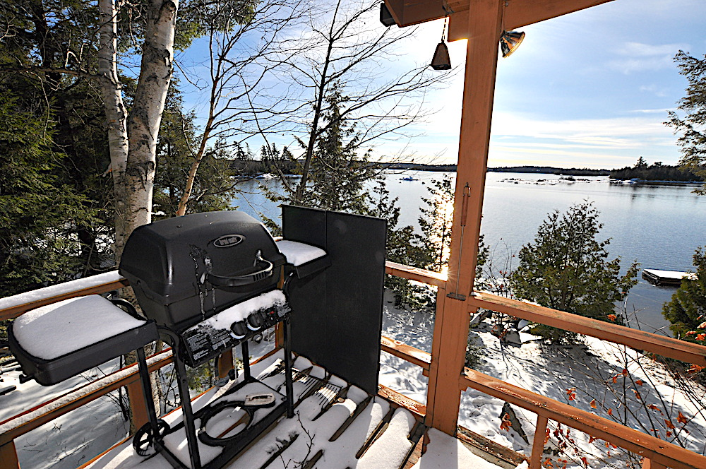 Kennisis Lake - Hideaway Bay - BBQ on the deck overlooking the lake