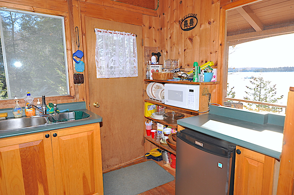 Kennisis Lake - Hideaway Bay - Kitchen view 2 with door to the side deck