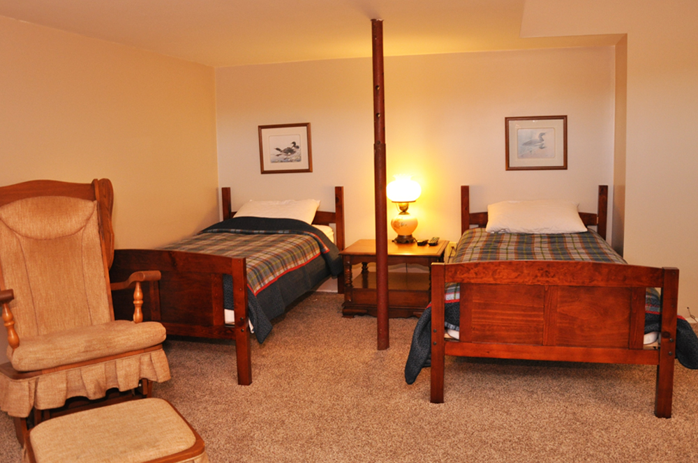 17-Bedroomrec-room-lower-level---pullout-and-2-singles