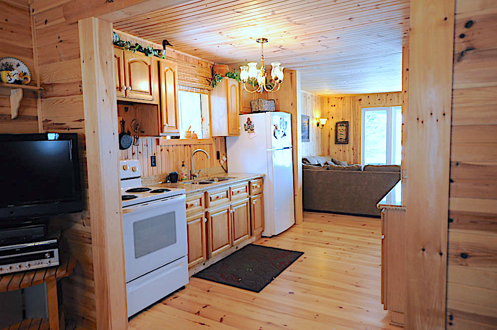 Blue Hawk Lake Blue Bell - Haliburton Cottage - Living-Room-into-Kitchen