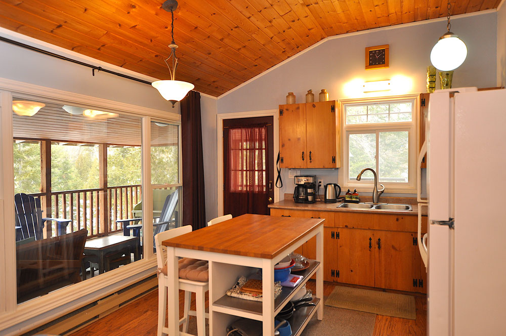 Haliburton Cottage - Gooderham Lake Into The Woods - Entrance-to-the-kitchen-view-to-the-screen-deck
