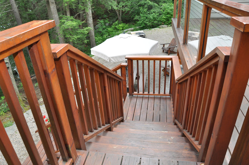 27-Stairs-to-the-picnic-table,-firepit-and-path-to-the-lake
